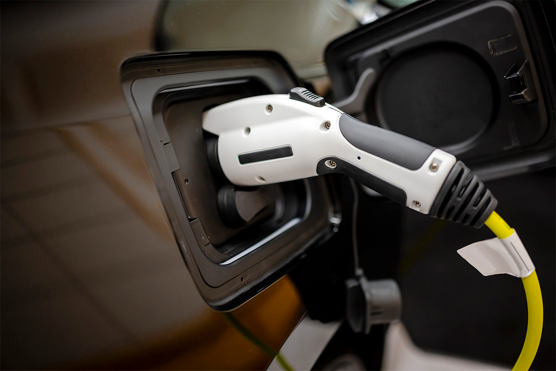 photo of a an electric vehicle charger in use