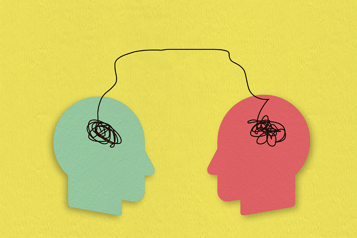 Photo illustration of two paper heads connected to each other by a line