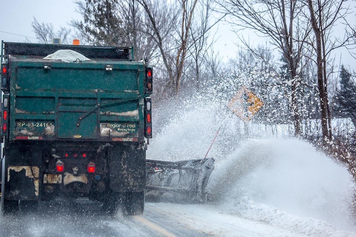 Snowplow plowing snow on a Peel Region street