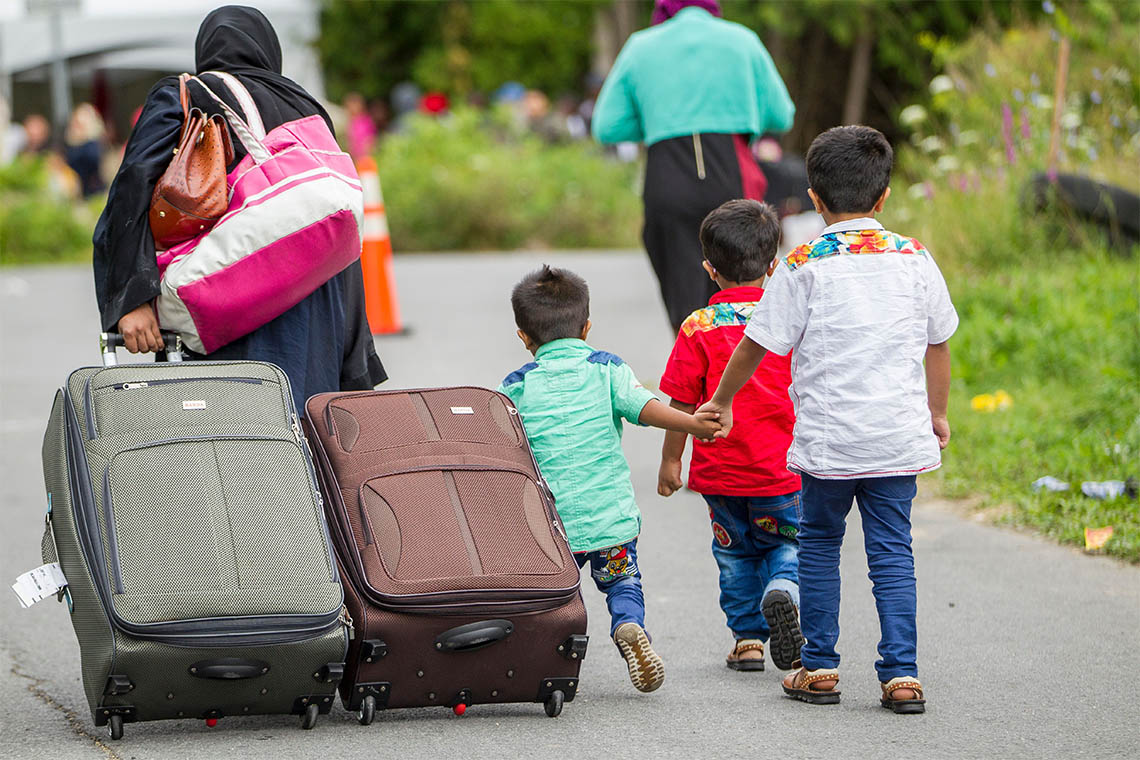 Photo of asylum-seekers making way to Canada-U.S. borders