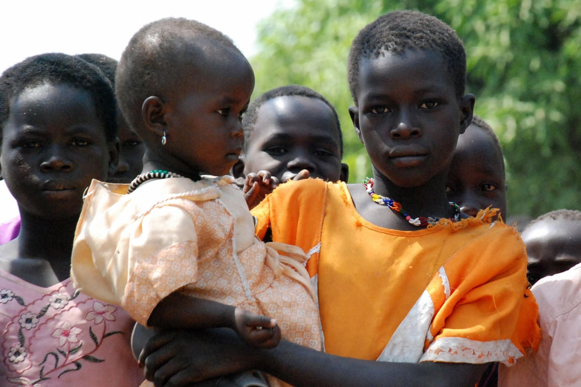 Displaced Sudanese children look into the camera