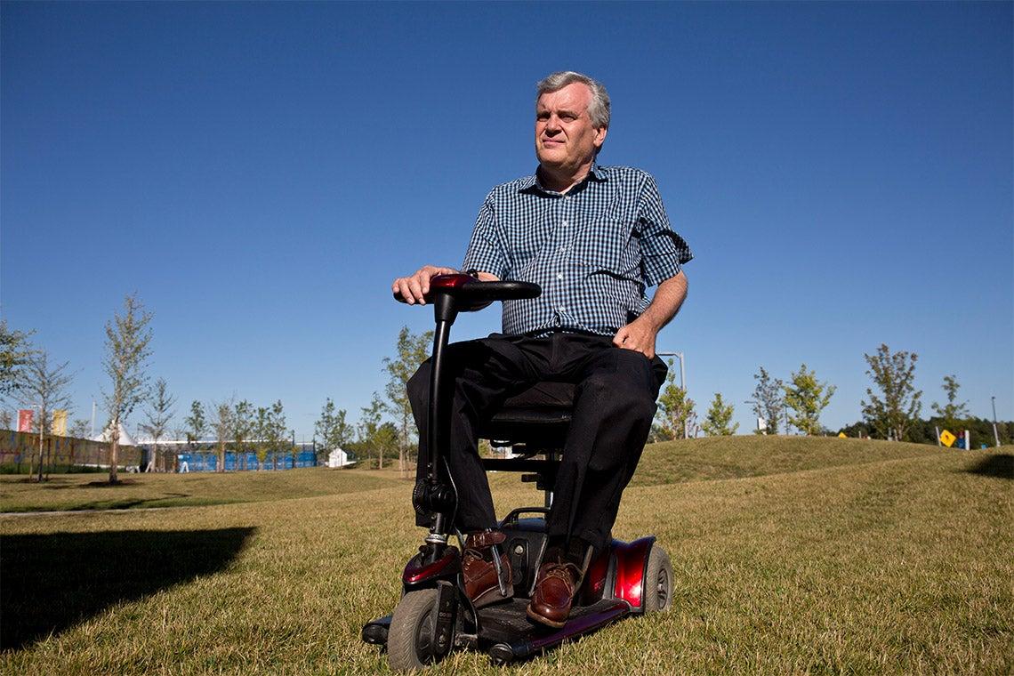 David Onley sit atop a mobility device