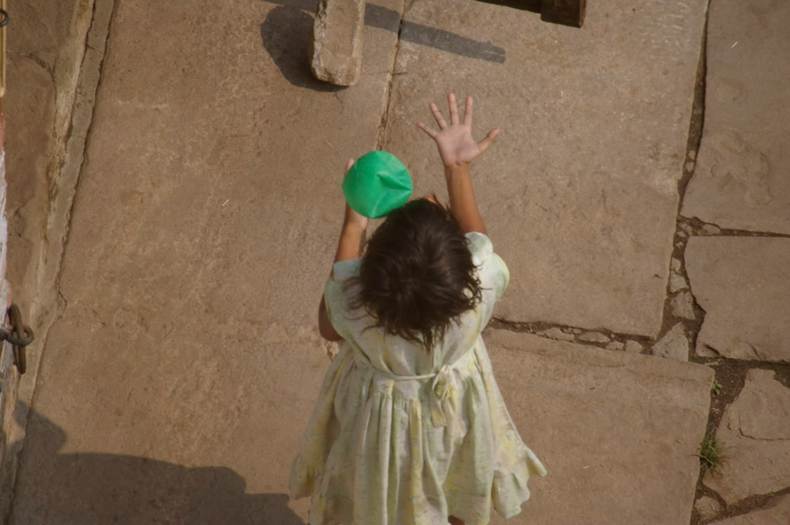 Girl playing with a ball photo