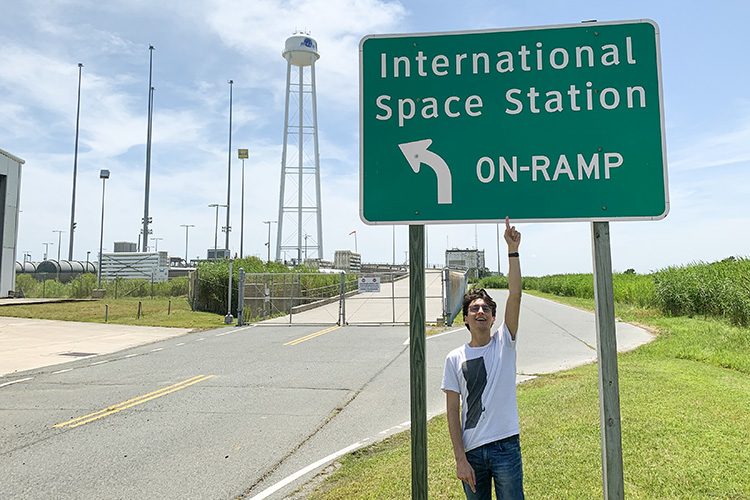 Georges Kanaan in front of a sign that says International Space Station On Romp