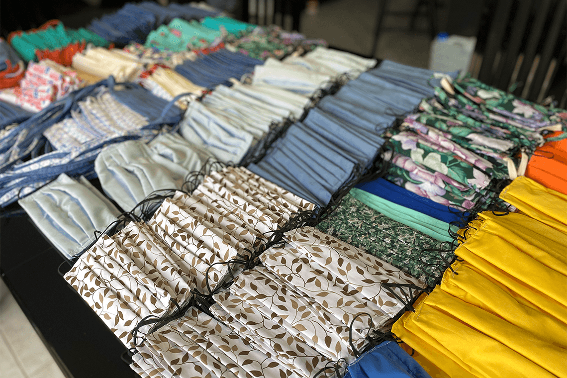 An array of colourful fabric face masks, representing how Indaggo helps organizations obtain medical and lab supplies.