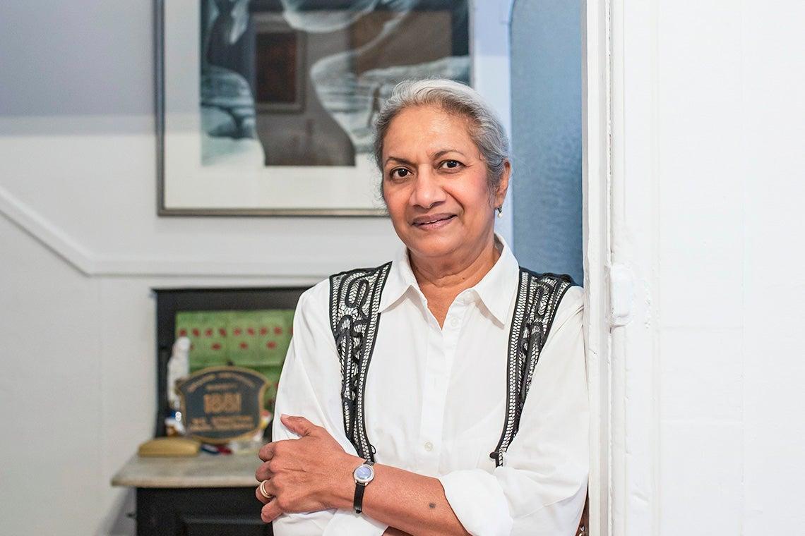 Photo of Ceta Ramkhalawansingh leaning on a doorway