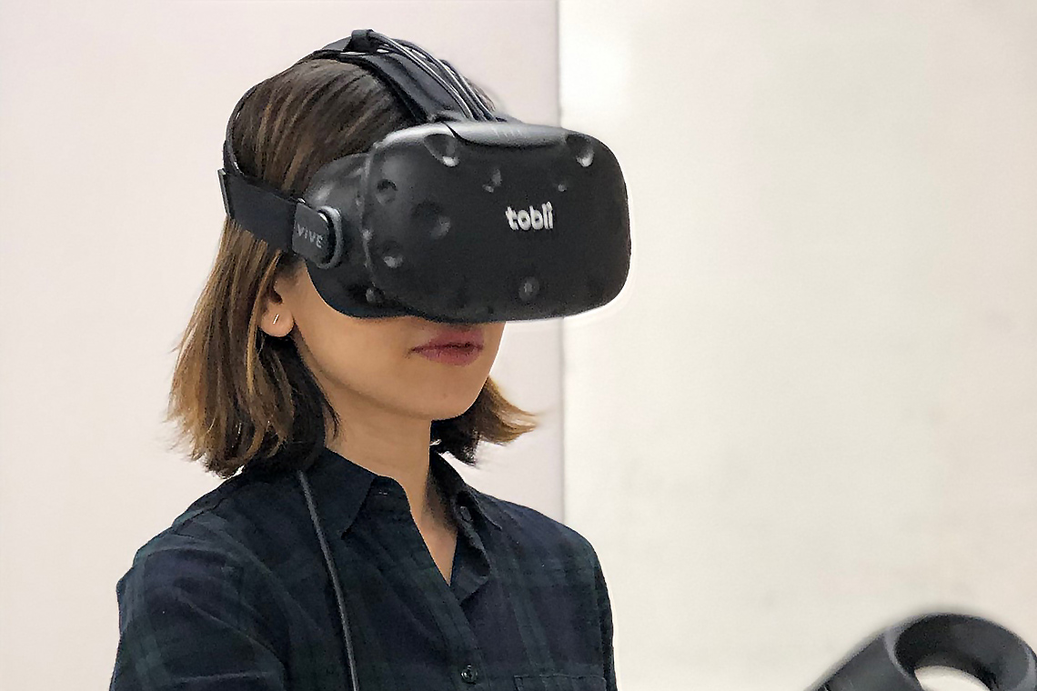 Researcher wearing a VR headset