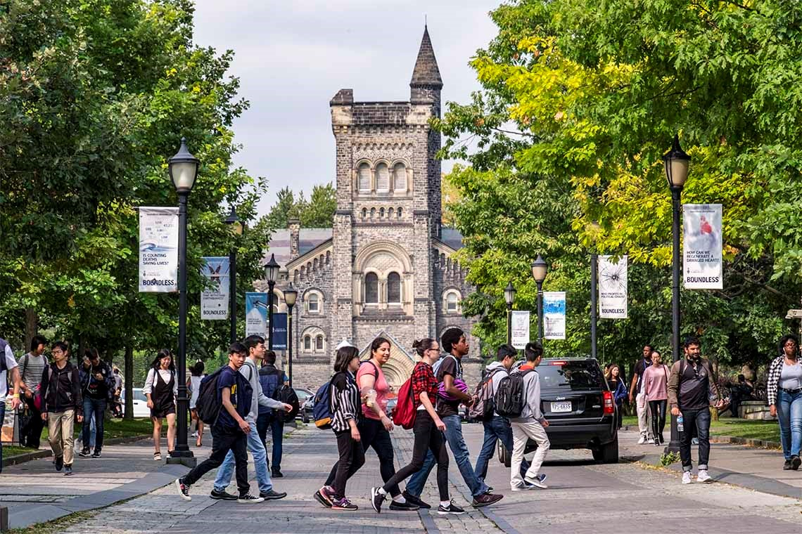 photo of students crossing road in front of University College