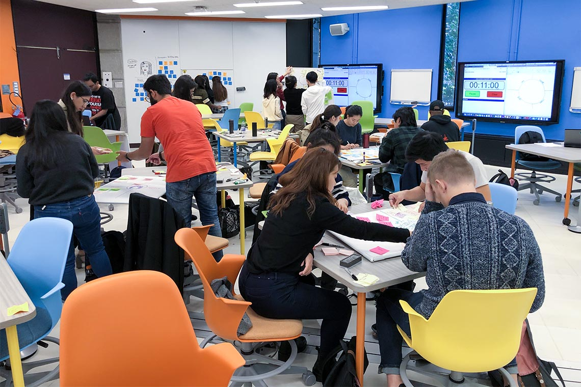 Students working in colourful Room 224 at the Bissell Building