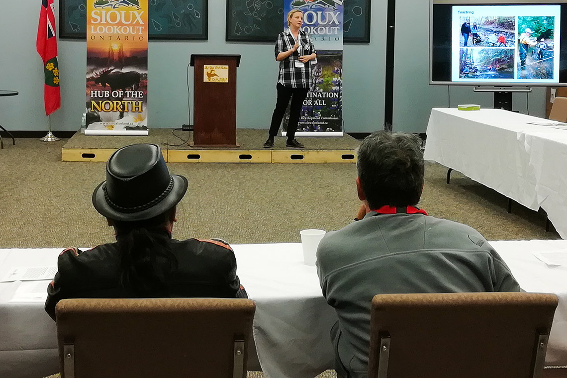 Photo of Jennifer Drake delivering a presentation at Sioux Lookout