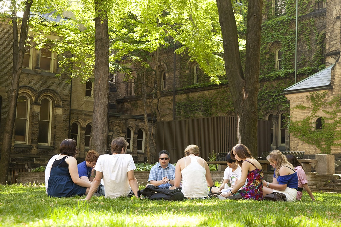 Students studying in UC quad