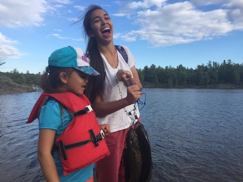 Symone and sister fishing