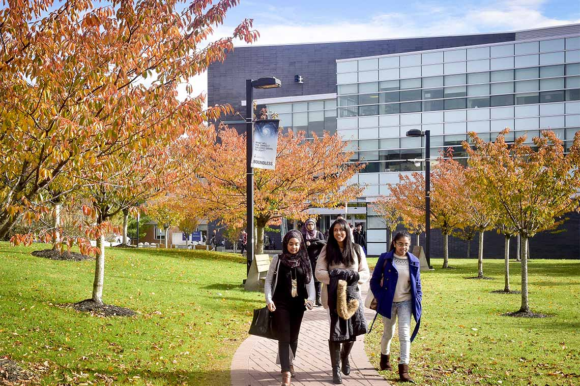 Students walking at UTSC campus during the fall