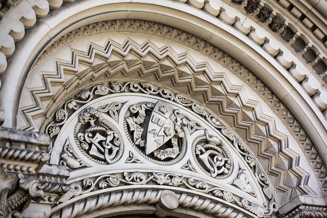 Photo of the stonework above the doors of University College