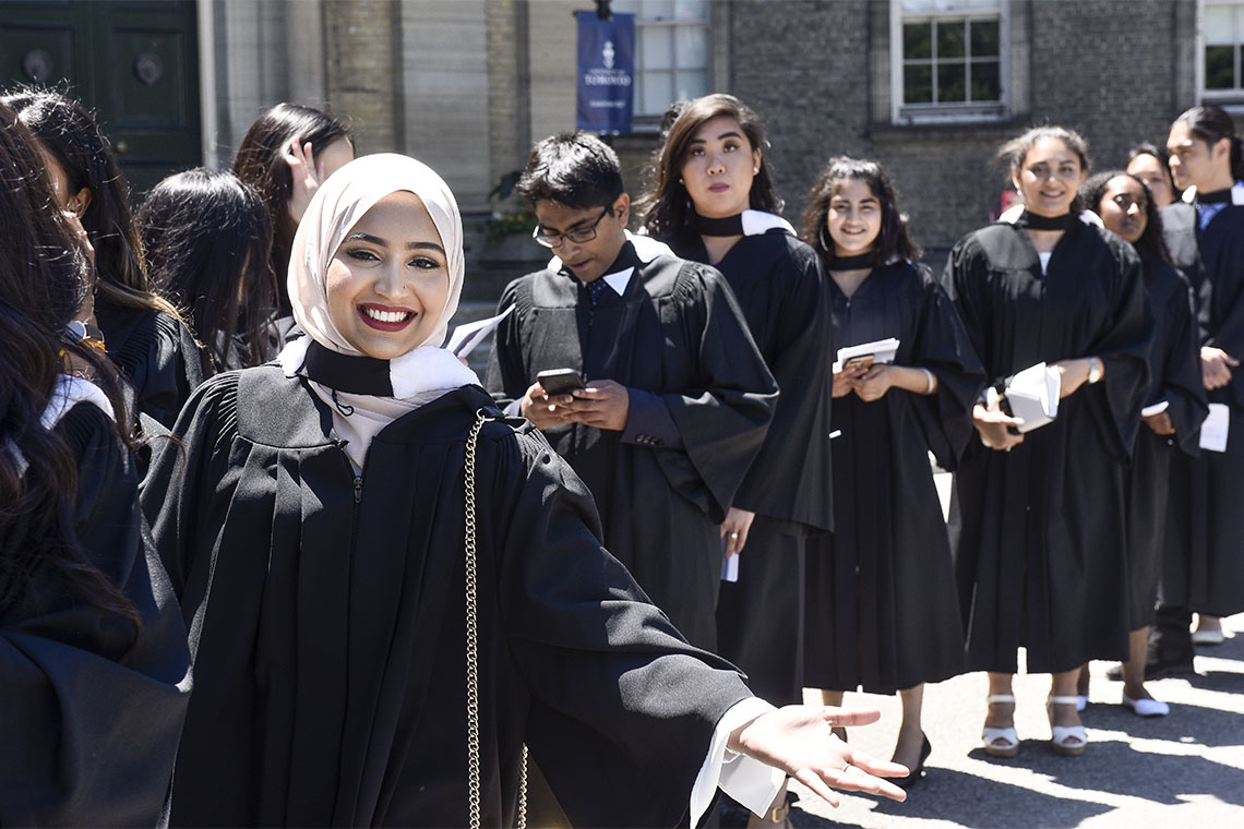 Graduands line up outside Simcoe Hall