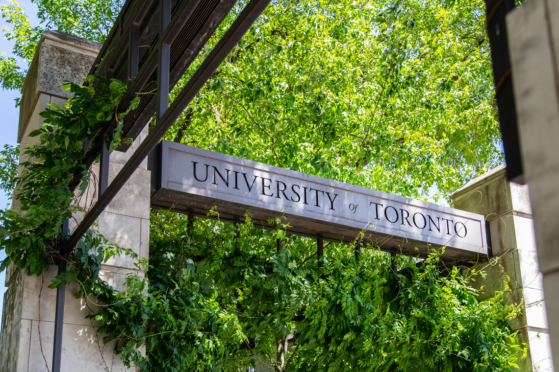 The U of T sign above the gates to the St. George campus