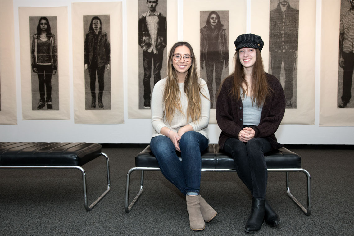 Student curators Nikita Lorenzo-Vicente and Amanda McNeil