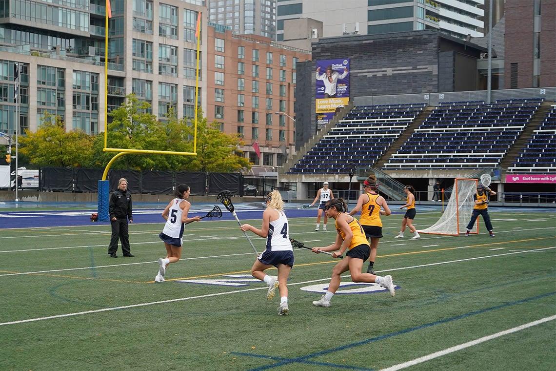 Women playing lacrosse at the Varsity Blues stadium