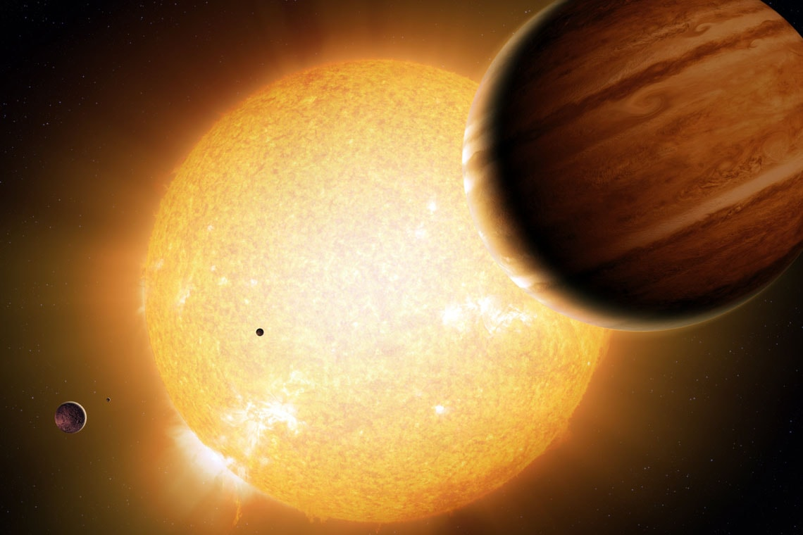 An artist's portrayal of a Warm Jupiter gas-giant planet in orbit around its parent star, along with smaller companion planets