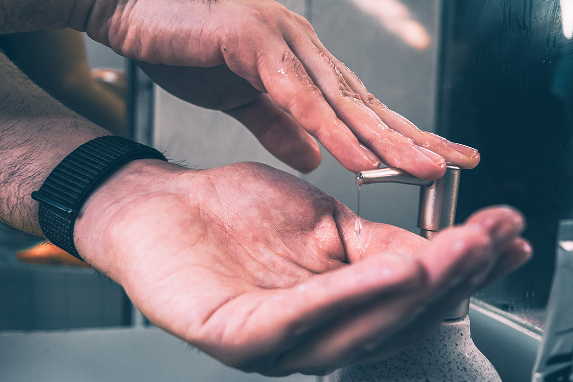 Close-up photo of hands being washed