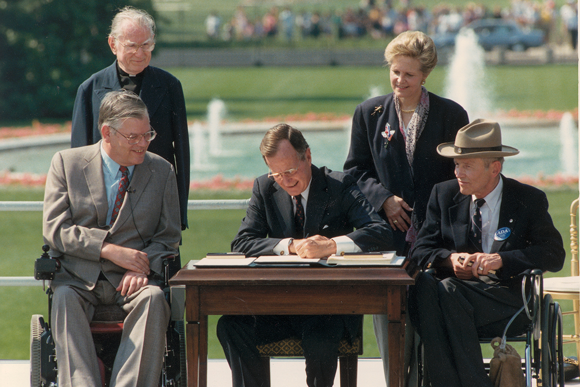 George H.W. Bush signing the Americans with Disabilities Act