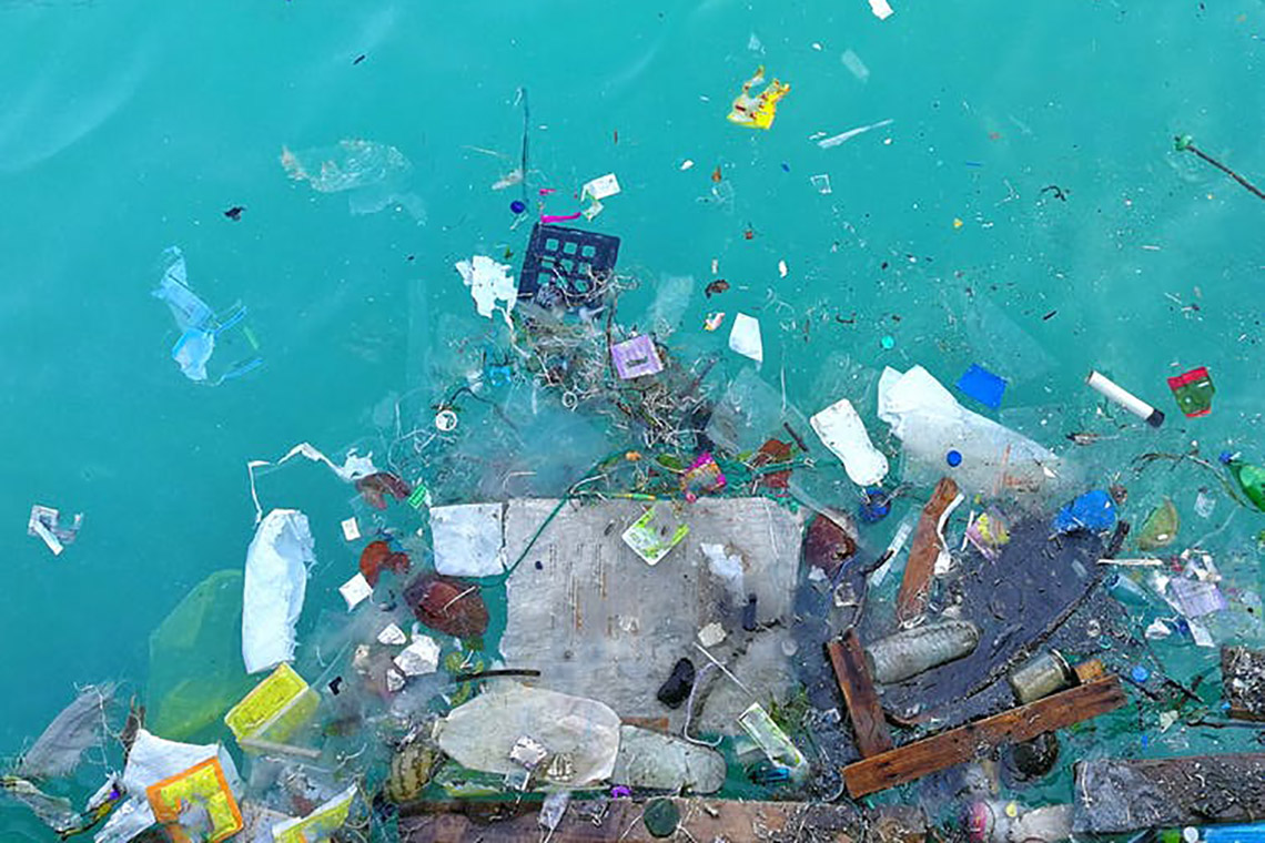 Photo of plastic pieces floating in the ocean