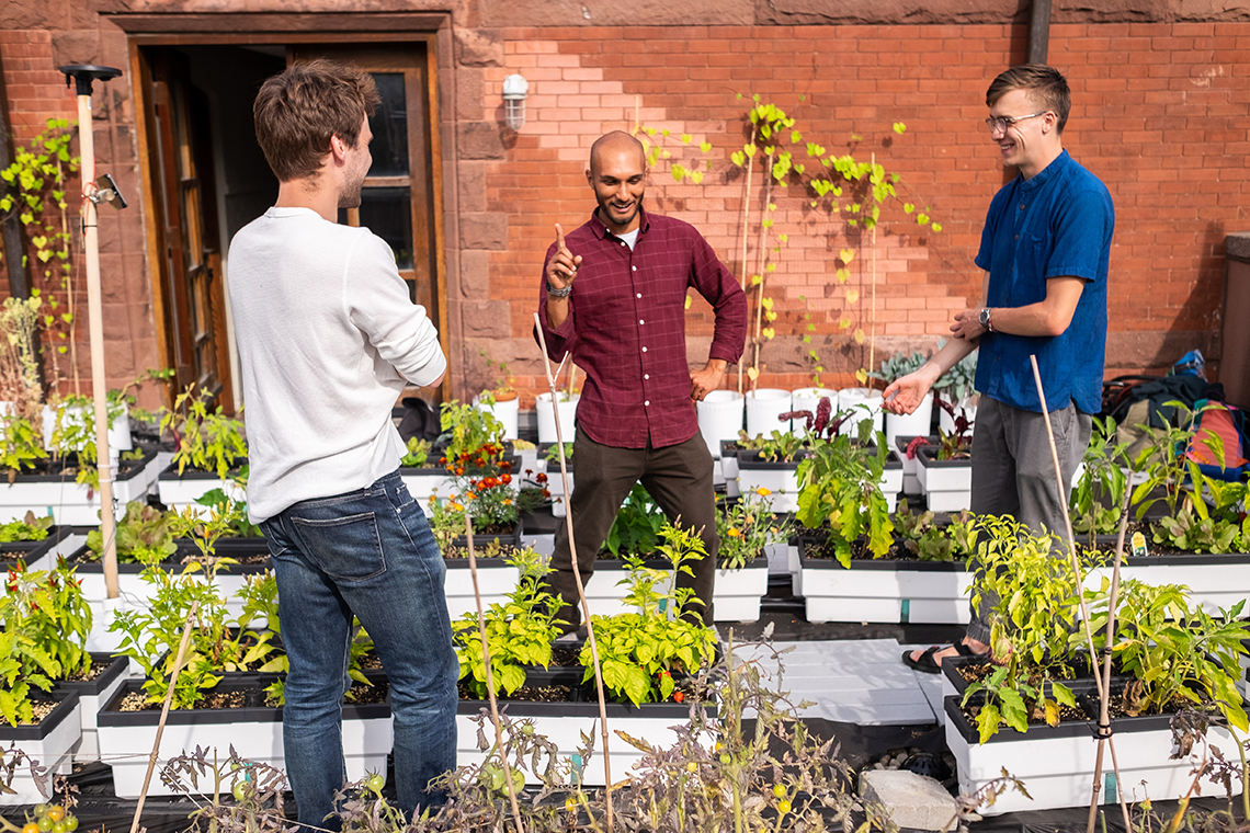 Nicolas Cote, Rashad Brugmann and Nathan Postma at the Trinity College rooftop garden