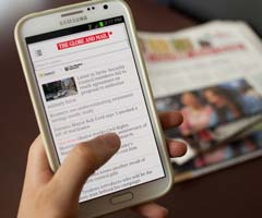 Smartphone displaying the Globe and Mail online