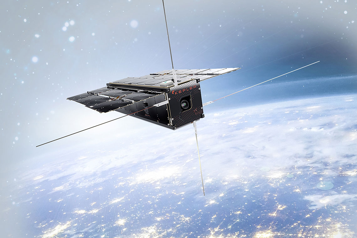 A Kepler Communications internet satellite floats above the nighttime Earth