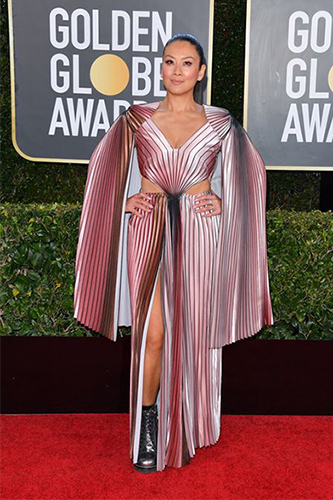 Lainey Lui on the Golden Globe red carpet wearing a lavender dress by Lesley Hampton