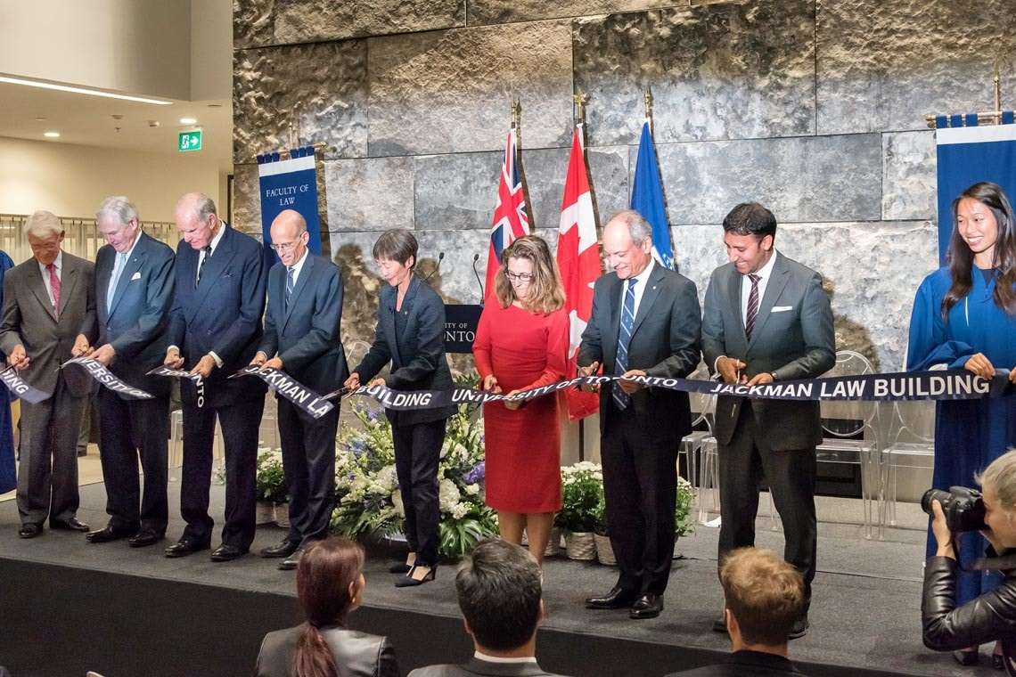 Cutting the ribbon - from left to right: Campaign Co-Chair Tom Rahilly, Chancellor Michael Wilson, the Hon. Hal Jackman, Dean Ed Iacobucci, Governing Council Chair Shirley Hoy, the Hon. Chrystia Freeland, Minister of International Trade with President Meric Gertler, alumnus and MP Arif Virani and Christina Liao, student gonfalonier.