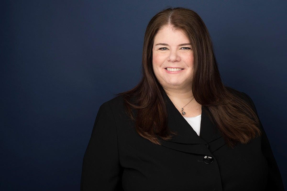 Portrait of Linda Hills against blue background