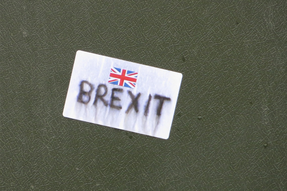 "luggage tag with United Kingdom flag and ""Brexit"" written below it"