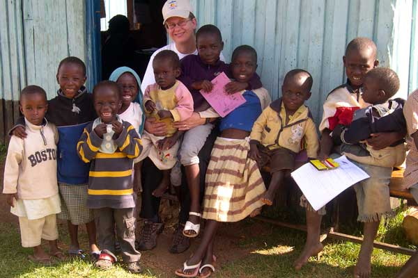 Photo of Associate Professor Paula Braitstein with children at an orphanage in Kenya