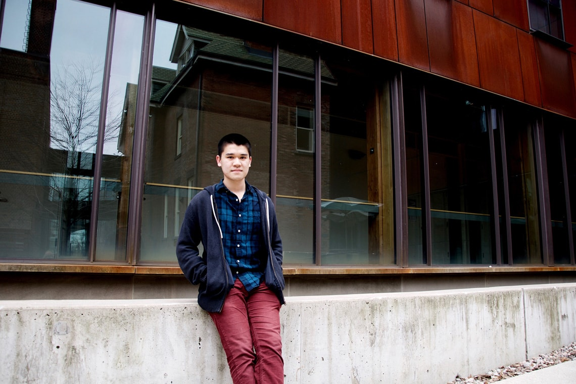 Student Quan Le in front of a building
