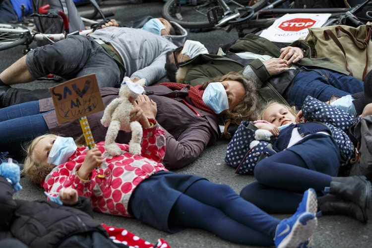 Anti-air pollution protesters lying on the ground in London, England