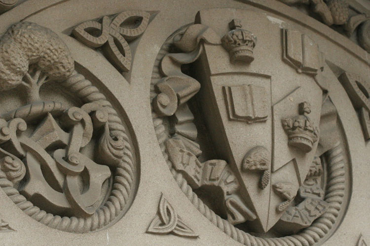 image of coat of arms carved in stone
