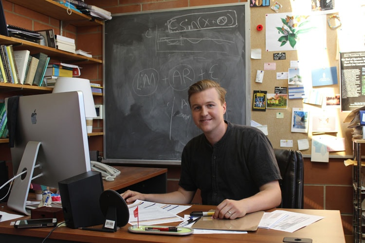 Scott MacIvor at his desk