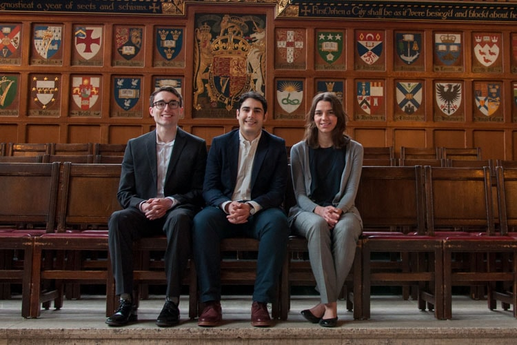 Three Rhodes Scholars (James Flynn, Kaleem Hawa and Jessica Phillips) sitting and smiling
