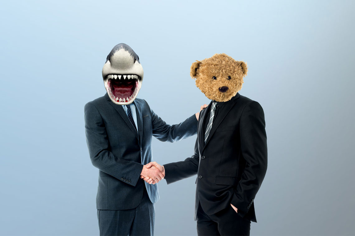 Photo of two people in suits shaking hands, one of whom has a shark for a head and the other with a teddy bear's head