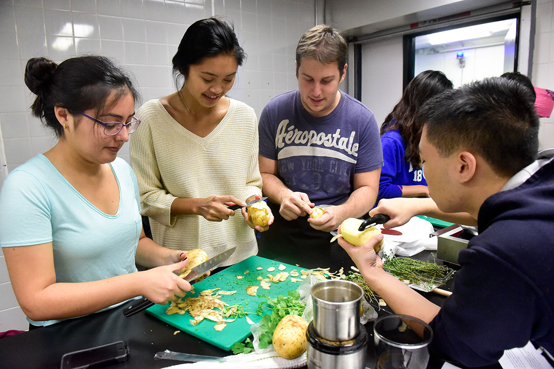 Photo of students pealing potatoes