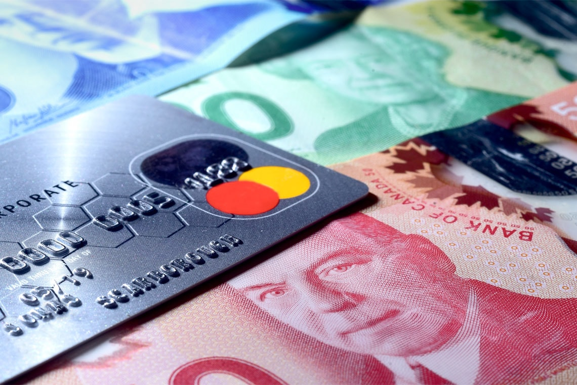 Close up photo of Canadian cash and credit card