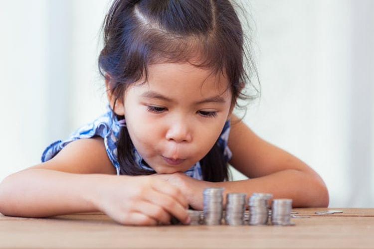 Photo of girl with money
