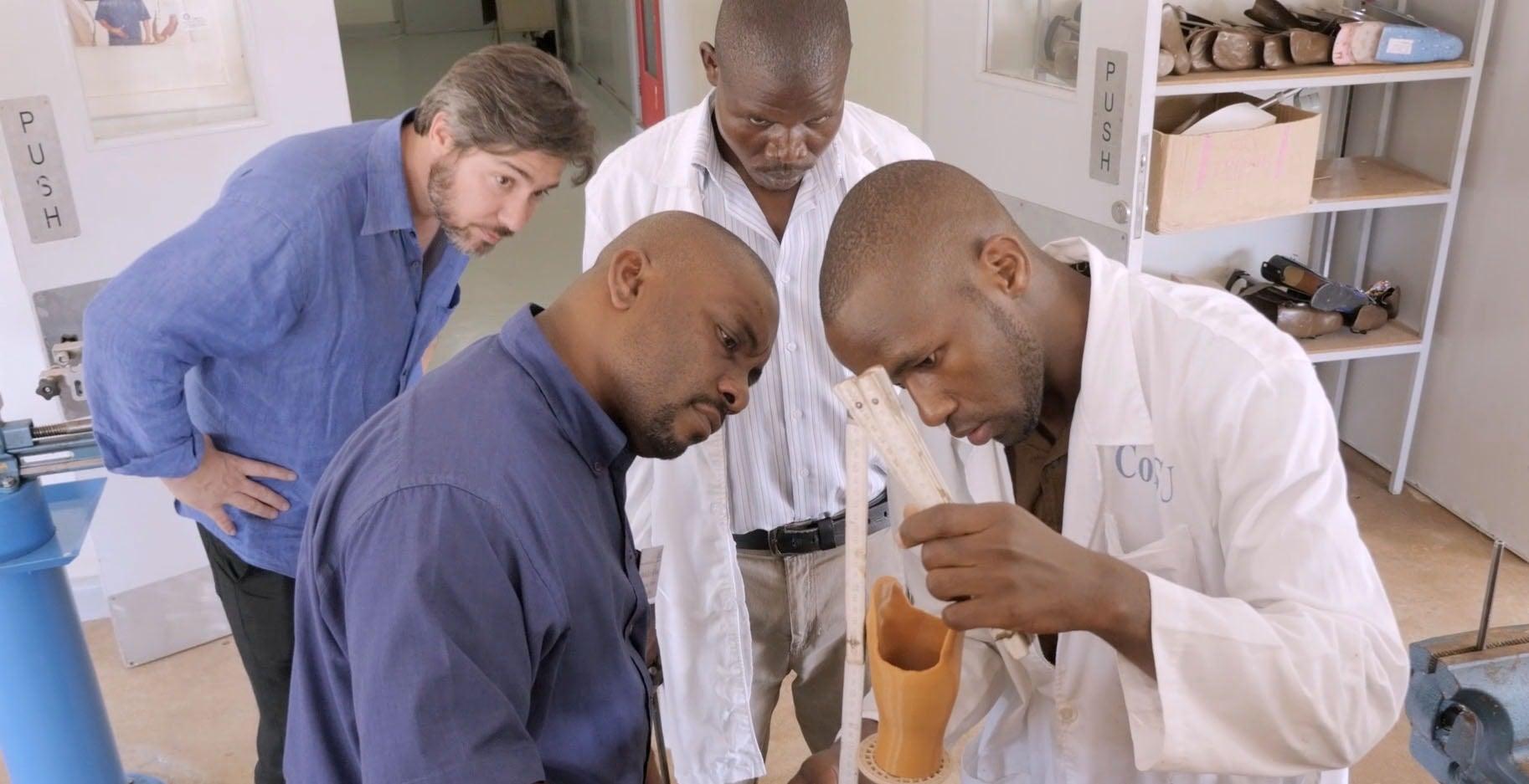 Medical doctors examine 3D prosthetic limb