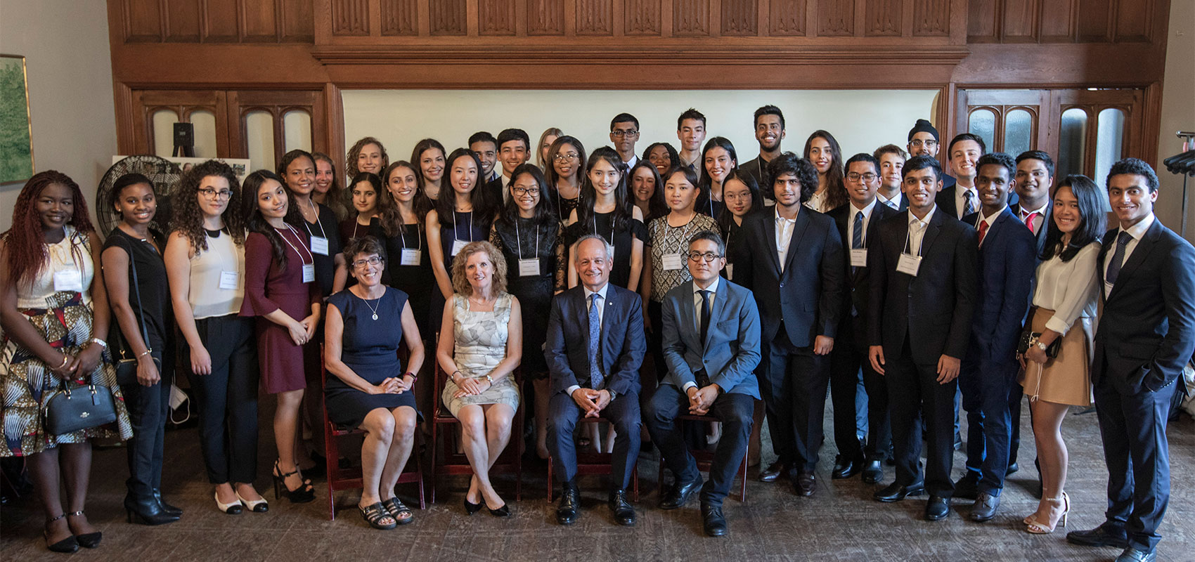 Emily Wen, a Rotman commerce student and Pearson Scholar from Massachusetts, speaks with U of T President Meric Gertler at a reception for the scholarship recipients