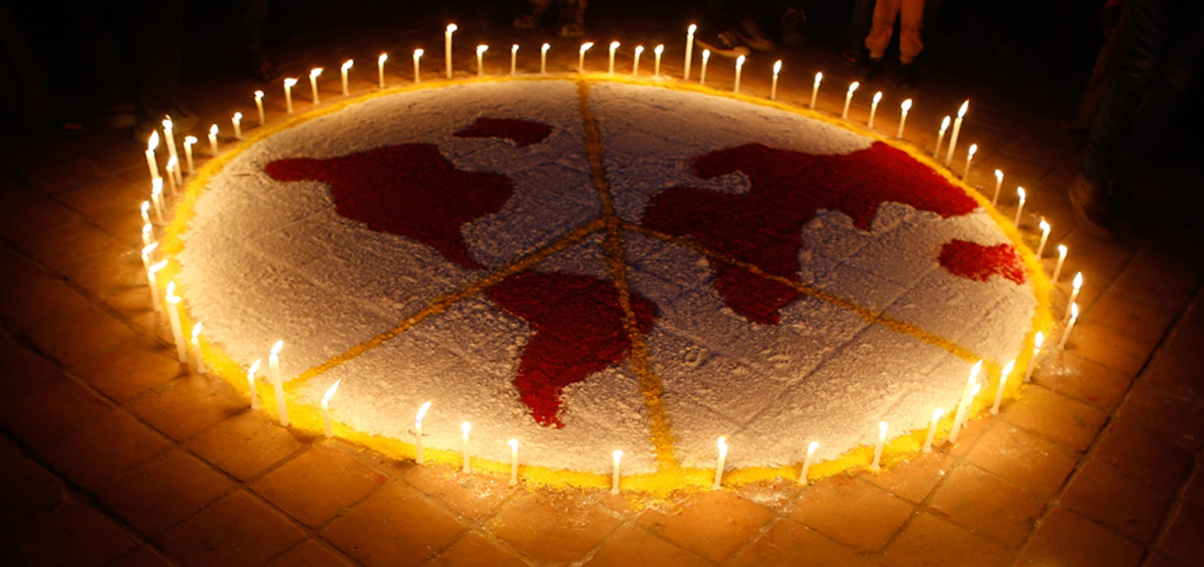 Candles making an outline of the world