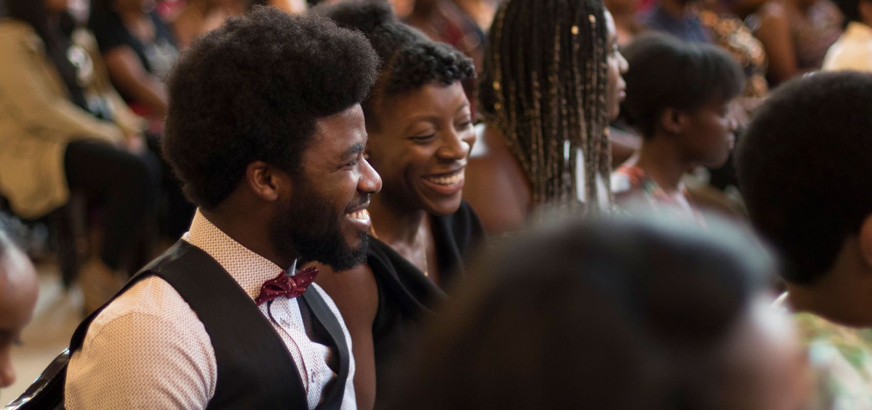 Photo of two smiling students at the first-ever Black graduation celebration at U of T.