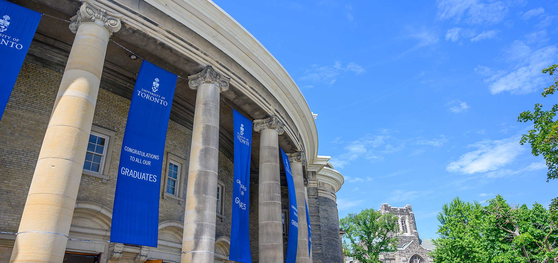 Graduation banners hang from the columns at Convocation Hall at the University of Toronto's St. George campus.