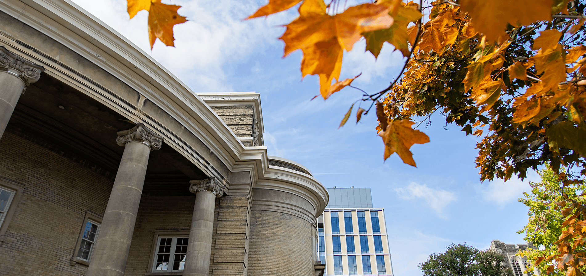 An autumn photo of Convocation Hall with red leaves in the foreground.