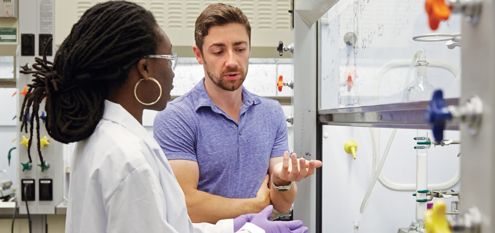 U of T professor Patrick Gunning in his lab with student